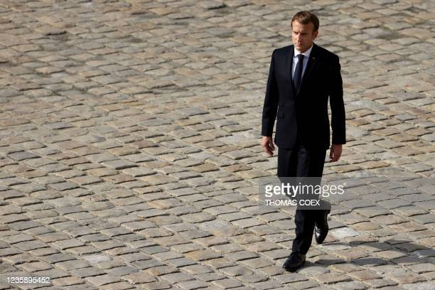 French President Emmanuel Macron walks as he attends the national memorial service for Hubert Germain - the last surviving Liberation companion - at...