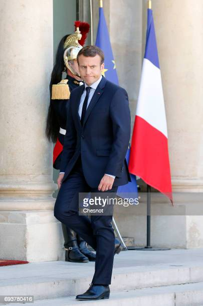 French President Emmanuel Macron walks back inside the Elysee Presidential Palace after his meetig with Peruvian President Pedro Pablo Kuczynski on...