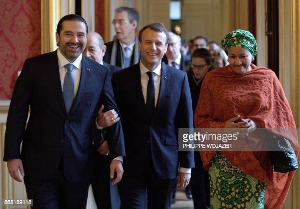 TOPSHOT French President Emmanuel Macron walks between Lebanon's Prime Minister Saad Hariri and UN Deputy Secretary General Amina Mohammed as they...