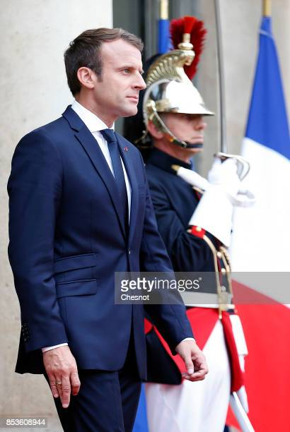French President Emmanuel Macron walks on the steps of the Elysee Presidential Palace prior to his meeting with Libanese President Michel Aoun on...