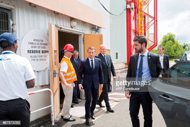 French President Emmanuel Macron walks to his vehicule after a visit to the Guiana Space Centre in Kourou on October 27 2017 as part of a threeday...