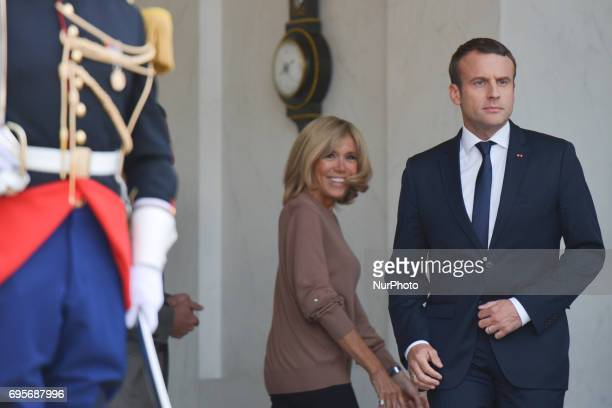 French President Emmanuel Macron watched by his wife Brigitte Macron ready to meet British PM Theresa May as she arrives at The Élysée Palace On...