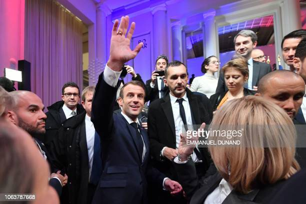 French President Emmanuel Macron waves after delivering a speech during a Frenchspeaking community reception at the BOZAR Centre for Fine Arts in...