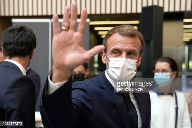French President Emmanuel Macron waves after his visit to the headquarters of the Paris 2024 Organising Committee for the Olympic and Paralympic...
