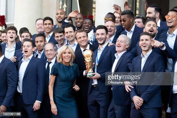 French president Emmanuel Macron waves his wife Brigitte Macron France's coach Didier Deschamps France's goalkeeper Hugo Lloris pose for a family...