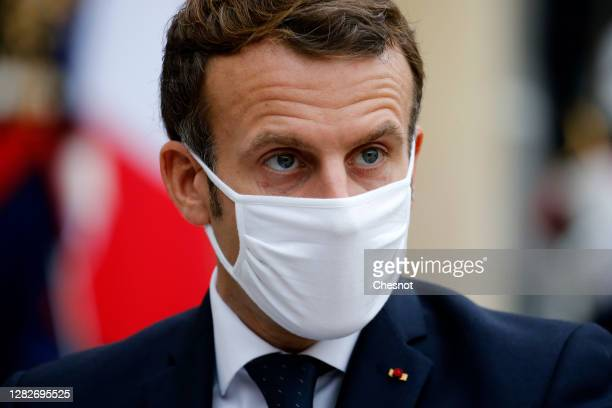 French President Emmanuel Macron (wearing a protective face mask Prime Minister Juri Ratas after following their meeting at the Elysee Palace on...