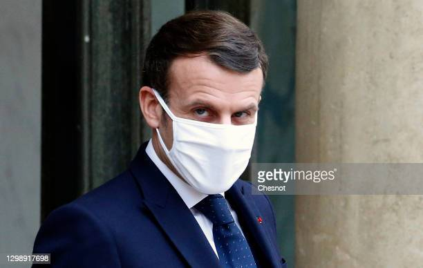 French President Emmanuel Macron wearing a protective face mask waits for Interim Malian President Bah N'daw prior to a working lunch at the Elysee...