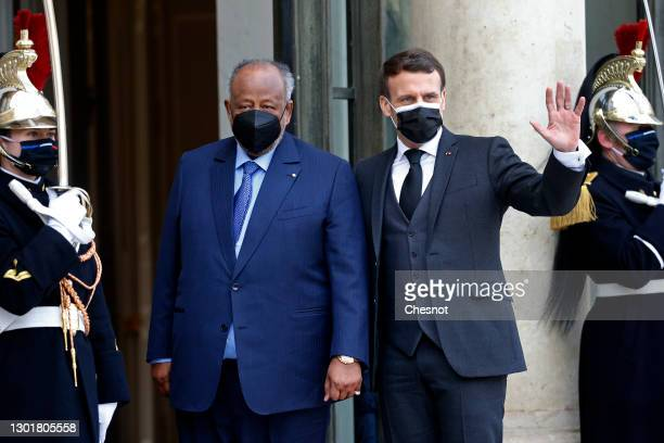 French President Emmanuel Macron wearing a protective face welcomes President of Djibouti Ismail Omar Guelleh prior to a working lunch at the Elysee...