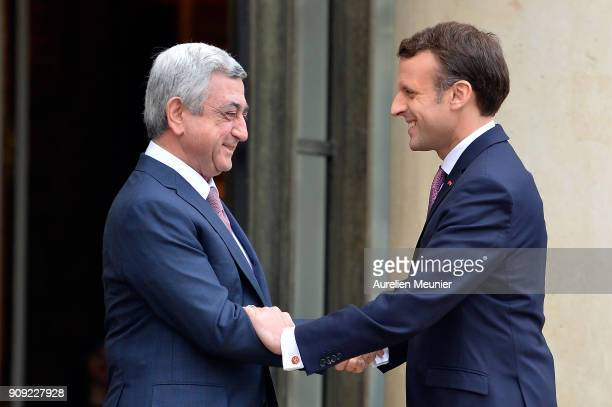 French President Emmanuel Macron welcomes Armenian President Serge Sarkissian at Elysee Palace on January 23 2018 in Paris France During this work...