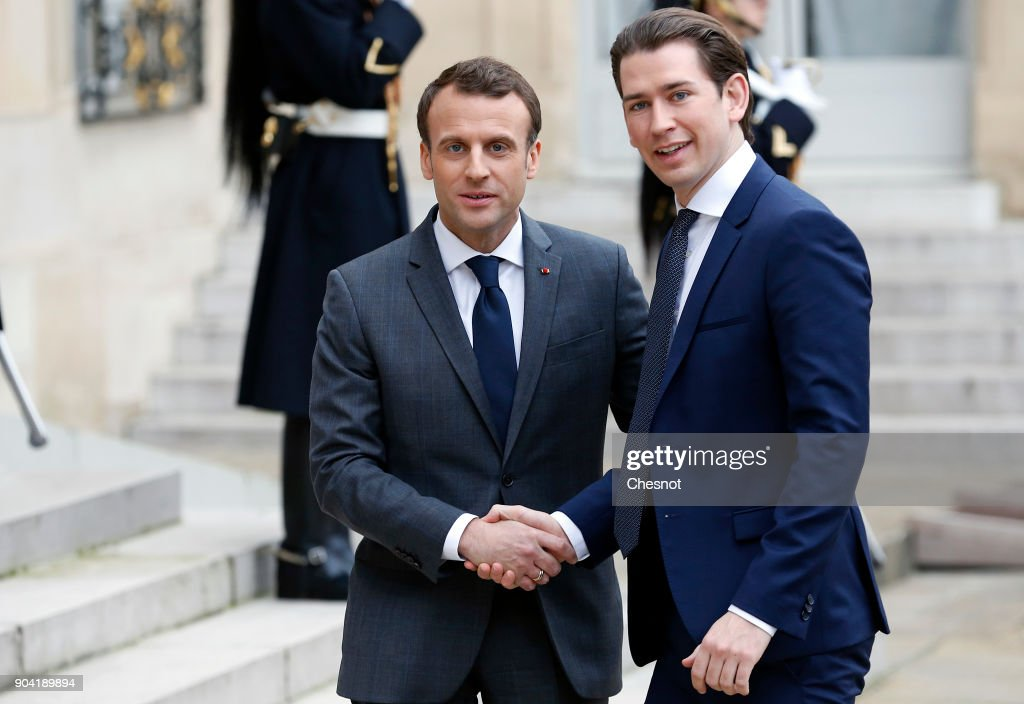 French President, Emmanuel Macron (L) welcomes Austrian Chancelor Sebastian Kurz prior to their meeting at the Elysee Presidential Palace on January 12, 2018 in Paris, France. He was appointed Chancellor at the age of 31, becoming the youngest head of government in the world. Kurz is in Paris for a one-day visit.
