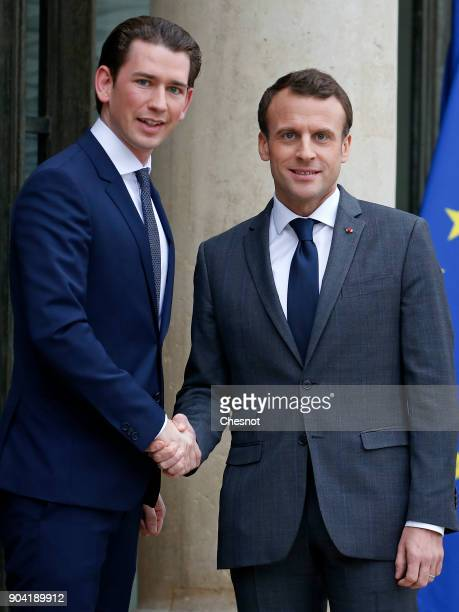 French President Emmanuel Macron welcomes Austrian Chancelor Sebastian Kurz prior to their meeting at the Elysee Presidential Palace on January 12...
