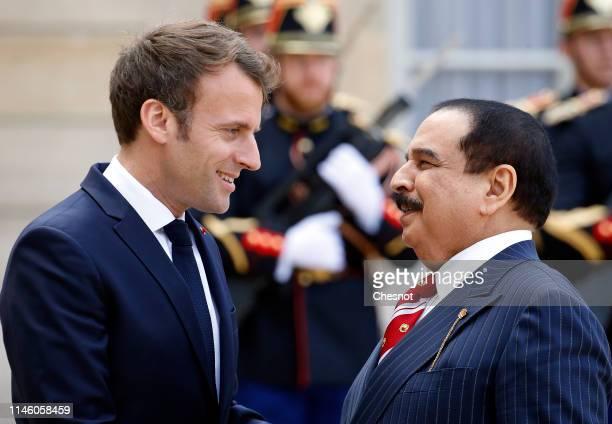 French President Emmanuel Macron welcomes Bahraini King Hamad bin Isa bin Salman Al Khalifa prior to their meeting at the Elysee Presidential Palace...