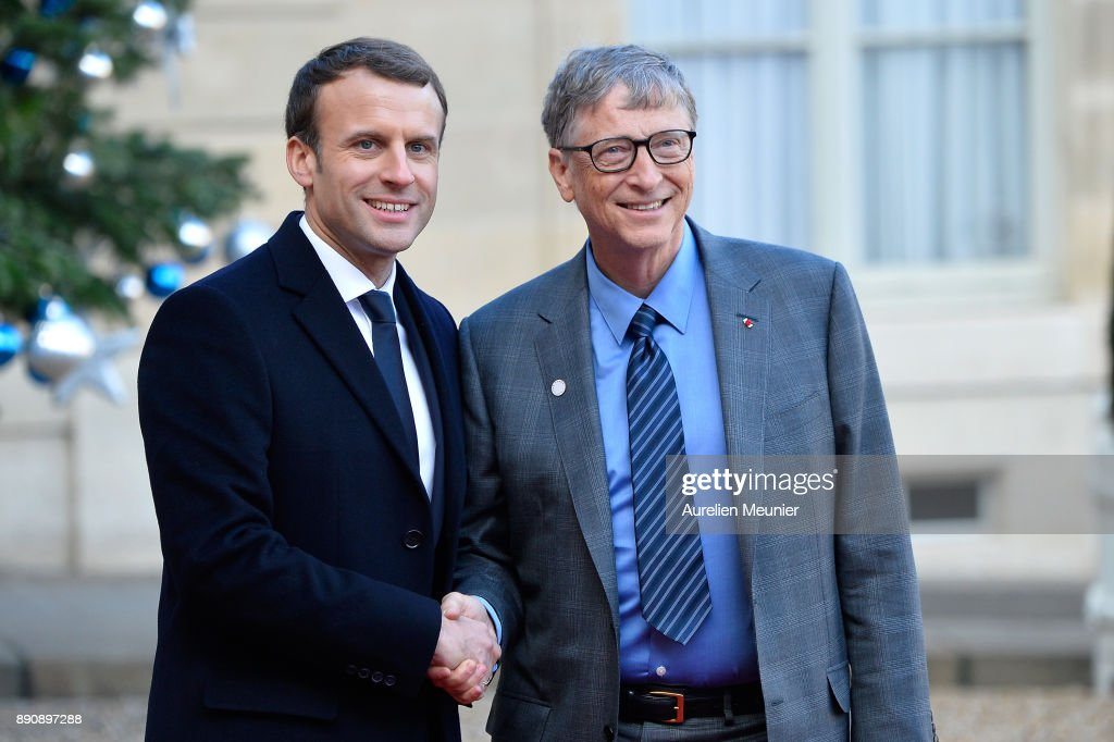 French President Emmanuel Macron welcomes Bill Gates as he arrives for a meeting for the One Planet Summit's international leaders at Elysee Palace on December 12, 2017 in Paris, France. Macron is hosting the One Planet climate summit, which gathers world leaders, philantropists and other committed private individuals to discuss climate change.