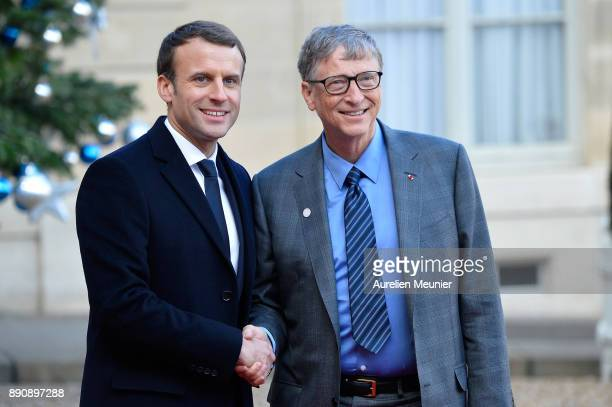 French President Emmanuel Macron welcomes Bill Gates as he arrives for a meeting for the One Planet Summit's international leaders at Elysee Palace...