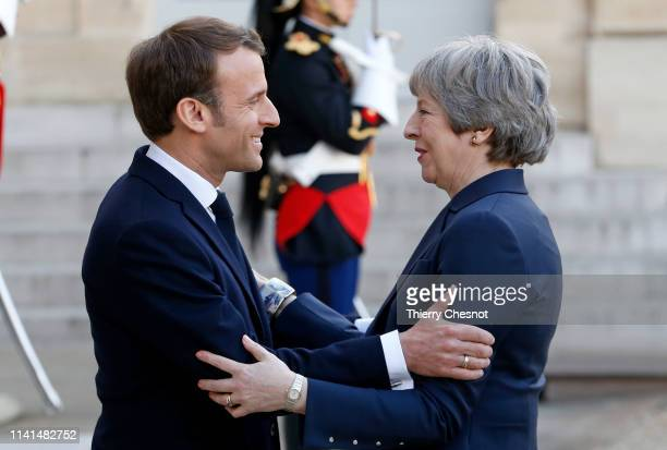 French President Emmanuel Macron welcomes British Prime Minister Theresa May prior to their meeting at the Elysee Presidential Palace on April 09...
