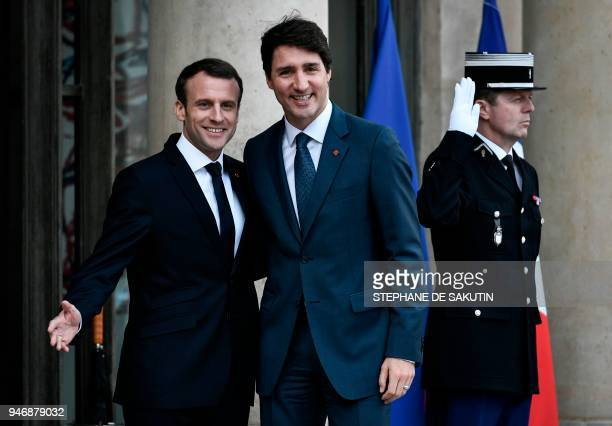French President Emmanuel Macron welcomes Canadian Prime Minister Justin Trudeau at the Elysee Palace in Paris on April 16 2018 / AFP PHOTO /...