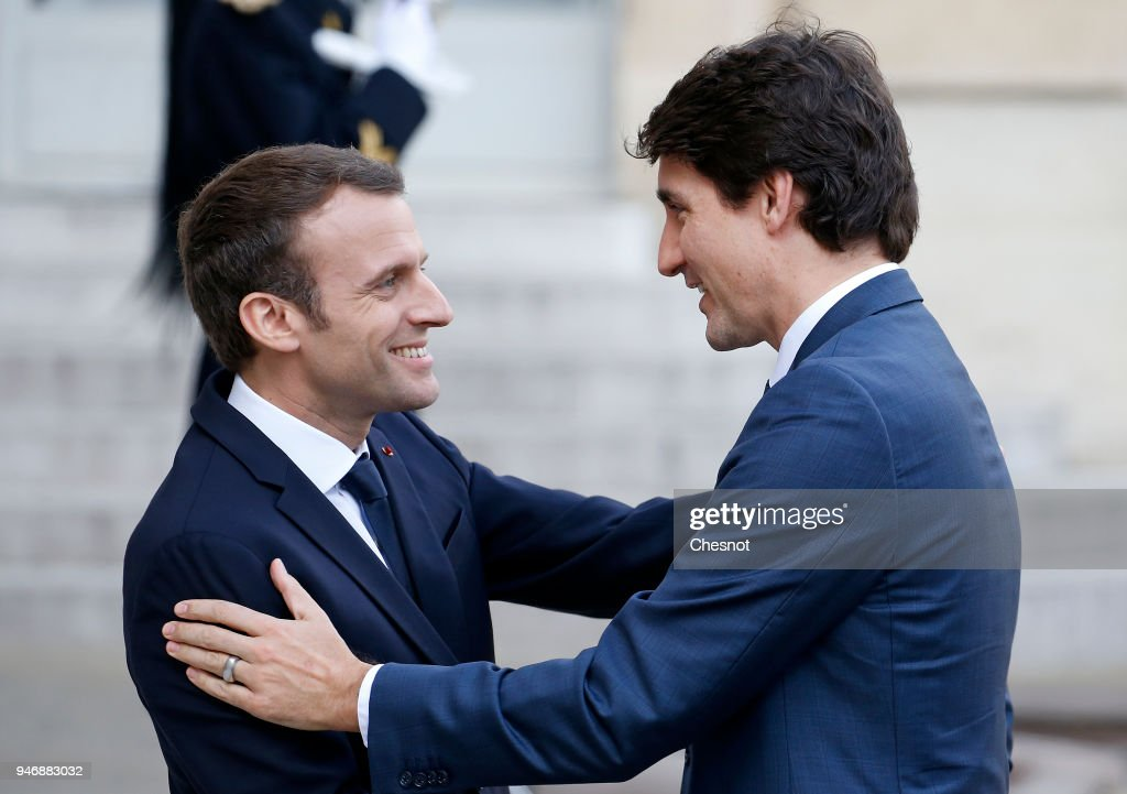 French president Emmanuel Macron (L) welcomes Canadian Prime Minister Justin Trudeau (R) prior their meeting at the Elysee Palace on April 16, 2018 in Paris, France. Trudeau is in Paris for a two-day visit.