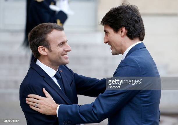 French president Emmanuel Macron welcomes Canadian Prime Minister Justin Trudeau prior their meeting at the Elysee Palace on April 16 2018 in Paris...