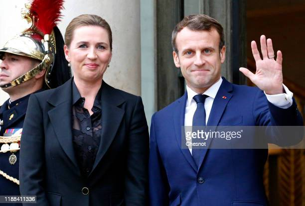 French President Emmanuel Macron welcomes Danish Prime Minister Mette Frederiksen prior to their meeting at the Elysee Presidential Palace on...