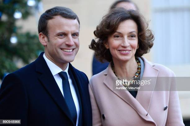 French President Emmanuel Macron welcomes Director General of Unesco Audrey Azoulay as she arrives for a meeting for the One Planet Summit's...