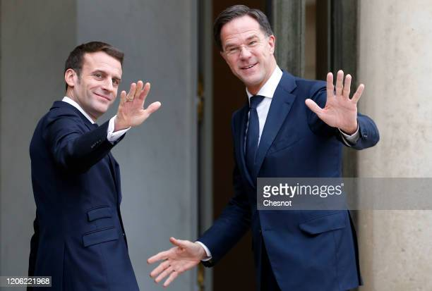 French President Emmanuel Macron welcomes Dutch Prime Minister Mark Rutte prior to a working lunch at the Elysee Presidential Palace on February 14...