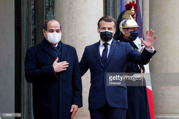 French President Emmanuel Macron welcomes Egyptian President Abdel Fattah al-Sisi prior to their meeting at the Elysee Presidential Palace on...