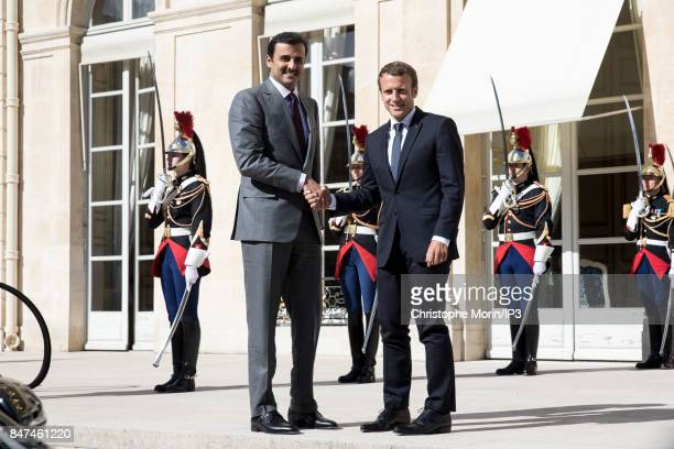 French President Emmanuel Macron welcomes Emir of Qatar Sheikh Tamim ben Hamad Al Thani at the Elysee Palace on September 15 2017 in Paris France...