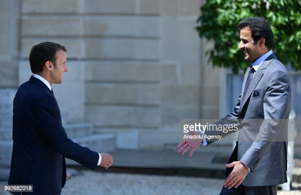 French President Emmanuel Macron welcomes Emir of Qatar Sheikh Tamim bin Hamad Al Thani at the Elysee Palace in Paris France on July 06 2018