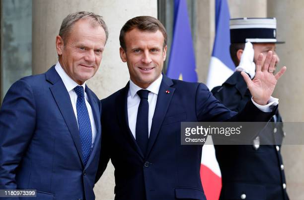 French President Emmanuel Macron welcomes European Council President Donald Tusk prior to their meeting at the Elysee Presidential Palace on October...