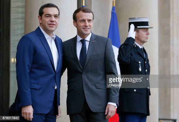 French President Emmanuel Macron welcomes Greek Prime Minister Alexis Tsipras prior to their meeting at the Elysee Presidential Palace on November 24...