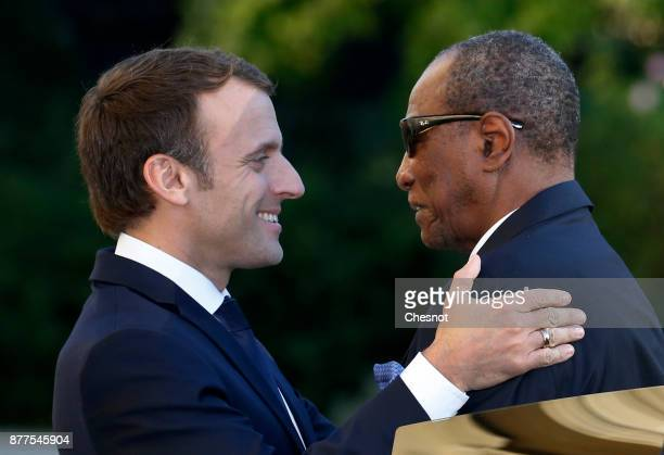 French President Emmanuel Macron welcomes Guinea's President and President of the African Union Alpha Conde prior to their meeting at the Elysee...
