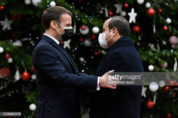 French President Emmanuel Macron welcomes his Egyptian counterpart Abdel Fattah al-Sisi at the Elysee presidential Palace on December 7, 2020 in...