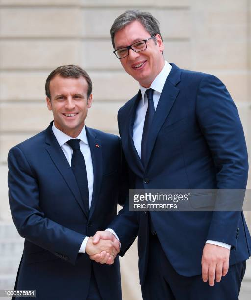 French President Emmanuel Macron welcomes his Serbian counterpart Aleksandar Vucic before a meeting at the Elysee Palace in Paris on July 17 2018