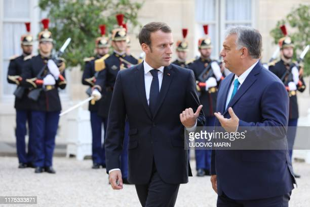 French President Emmanuel Macron welcomes Hungary's Prime minister Viktor Orban at the Elysee presidential palace before a meeting on October 11 2019...
