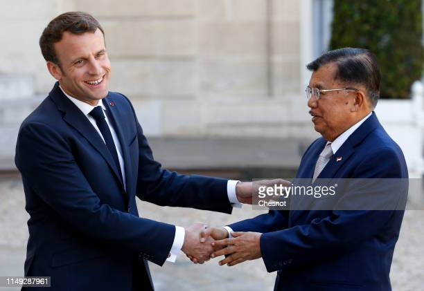 French President Emmanuel Macron welcomes Indonesia's Vice President Jusuf Kalla prior to their meeting at the Elysee Palace on May 15, 2019 in...