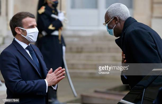 French President Emmanuel Macron welcomes Interim Malian President Bah N'daw prior to a working lunch at the Elysee Presidential Palace on January...