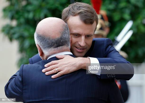 French President Emmanuel Macron welcomes Iraq's Prime Minister Haidar AlAbadi prior to their meeting at the Elysee Presidential Palace on October 05...