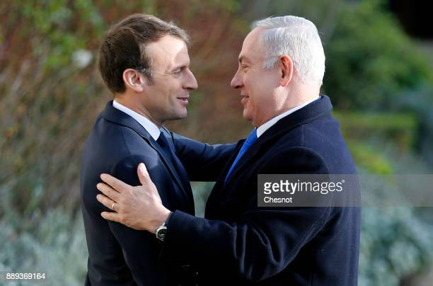 French President Emmanuel Macron welcomes Israeli Prime Minister Benjamin Netanyahu prior to their meeting at the Elysee Presidential Palace on...