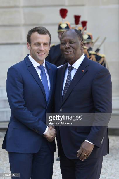 French President Emmanuel Macron welcomes Ivory Coast President Alassane Dramane Ouattara for a meeting at Elysee Palace on April 20, 2018 in Paris,...