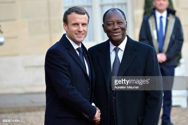 French President Emmanuel Macron welcomes Ivory Coast President Alassane Ouattara as he arrives for a meeting for the One Planet Summit's...