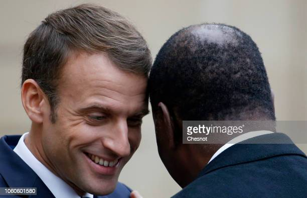 French President Emmanuel Macron welcomes Ivory Coast's President Alassane Ouattara at the Elysee Presidential Palace on November 12, 2018 in Paris,...