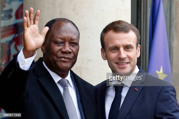 French President Emmanuel Macron welcomes Ivory Coast's President Alassane Ouattara prior to their meeting at the Elysee Presidential Palace on...