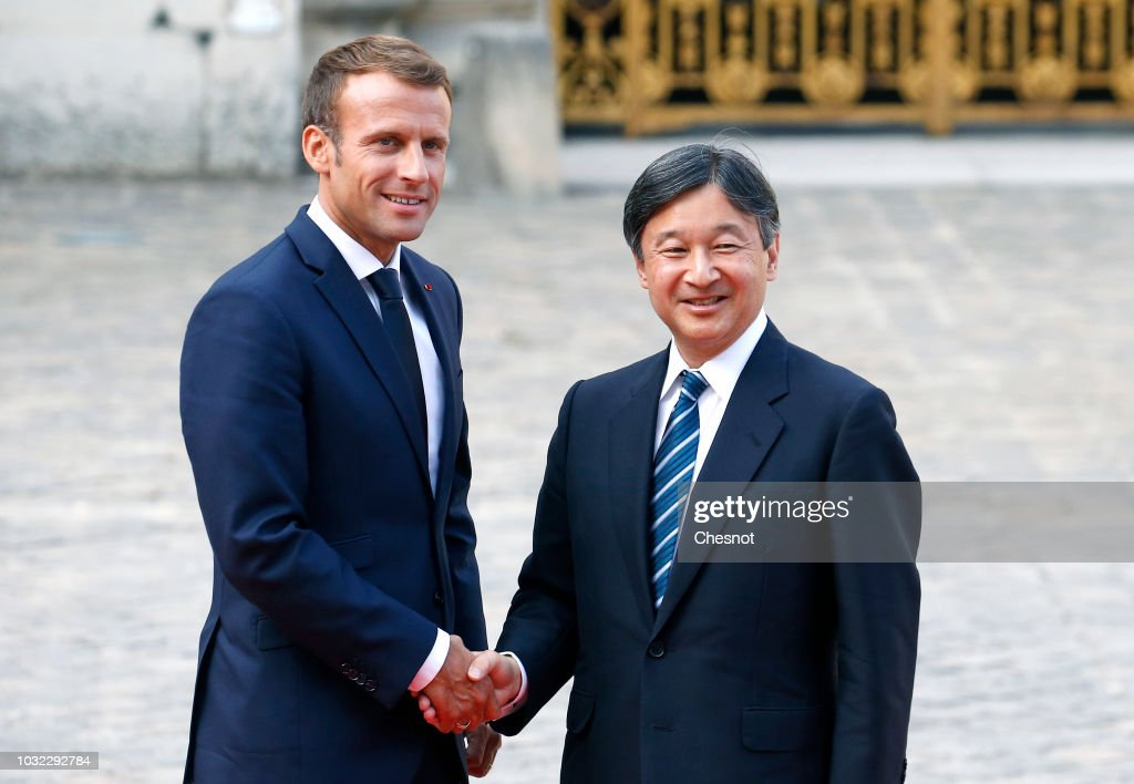 French President Emmanuel Macron welcomes Japan's Crown Prince Naruhito prior to their meeting at the Chateau de Versailles on September 12, 2018 in Versailles, France. Crown Prince Naruhito, who will become Emperor on May 1, 2019, is visiting France from September 7 to 15, as part of the 160th anniversary of the signing of the first diplomatic and trade treaty between France and Japan.