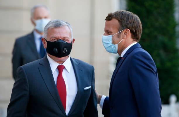 FRA: French President Emmanuel Macron Receives King Abdullah II Of Jordan And Queen Rania Of Jordan At Elysee Palace