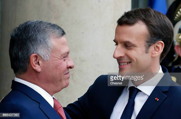 French President Emmanuel Macron welcomes Jordan's King Abdullah II prior to their meeting at the Elysee Presidential Palace on December 19 2017 in...