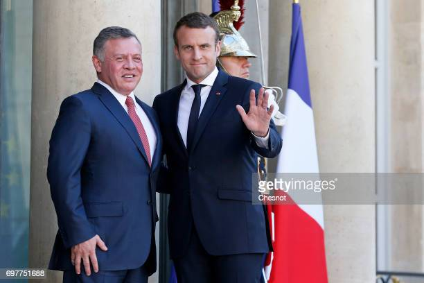 French President Emmanuel Macron welcomes King Abdallah II of Jordan prior to a meeting at the Elysee Presidential Palace on June 19 in Paris France...