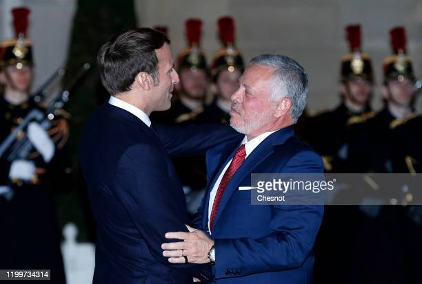 French President Emmanuel Macron welcomes King Abdullah II of Jordan prior to their working dinner at the Elysee Presidential Palace on January 15,...
