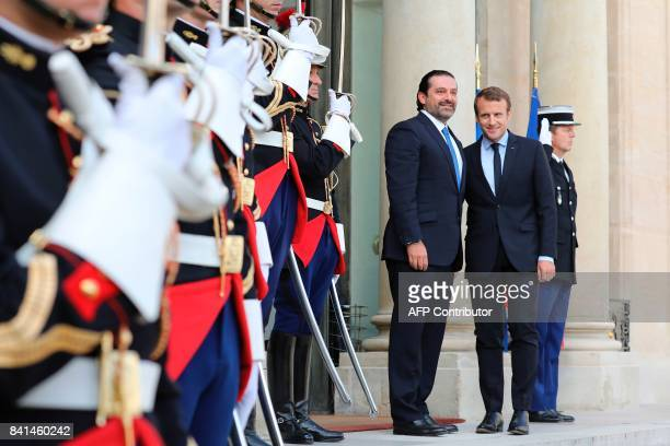 French President Emmanuel Macron welcomes Lebanese Prime Minister Saad Hariri before a meeting at the Elysee Palace in Paris on September 1 2017 /...