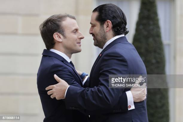French President Emmanuel Macron welcomes Lebanese Prime Minister Saad Hariri at the Elysee Presidential Palace on November 18, 2017 in Paris. Hariri...