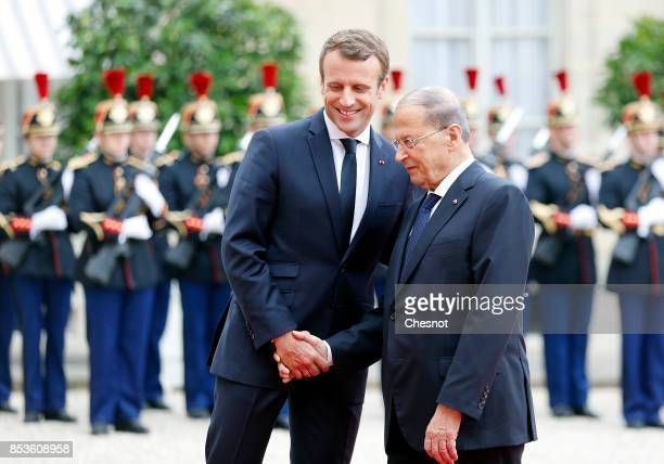 French President Emmanuel Macron welcomes Libanese President Michel Aoun prior to their meeting at the Elysee Presidential Palace on September 25...